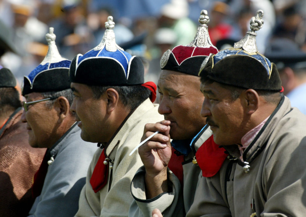 Elderly Mongolian wrestlers watch traditional wrestling matches during Naadam Festival July 12, 2003. Some 500 wrestlers from all over Mongolia competed in one of the highlights of Naadam. Naadam is the biggest event in the Mongolian calendar held July 11 to 13, on the anniversary of the Mongolian revolutionof 1921. - RTXM3KU
