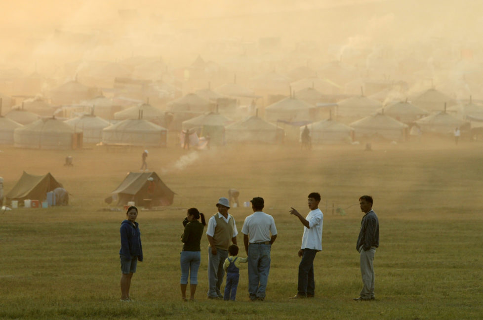 Mongolians gather near traditional tent houses known as 'ger' near a horserace venue during Naadam Festival at Khui Doloon Khudag village, some 35 kms (22 miles) from capital Ulan Bator July 12, 2003. Naadam is the biggest event in the Mongolian calendar held July 11 to 13, on the anniversary of the Mongolian revolution of 1921. - RTXM3KT