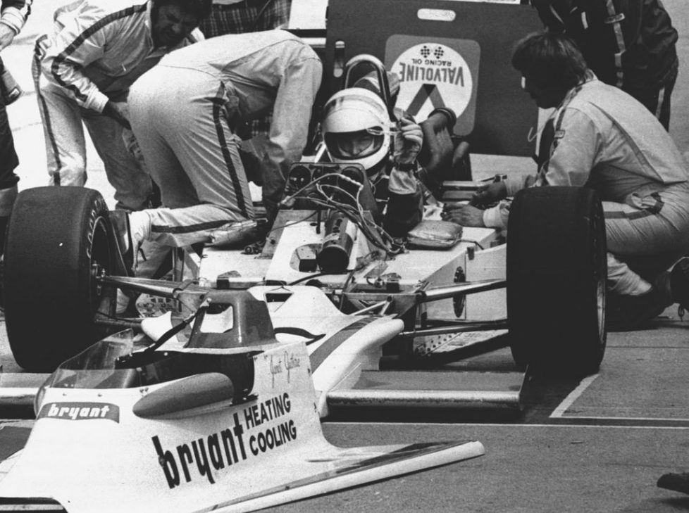 FILE - In this May 29, 1977 file photo, Janet Guthrie, the first woman to enter the Indianapolis 500 auto race, is shown in her car as her pit crew works prior to the 61st running of the Indianapolis 500 auto race in Indianapolis, Ind. (AP Photo/File)