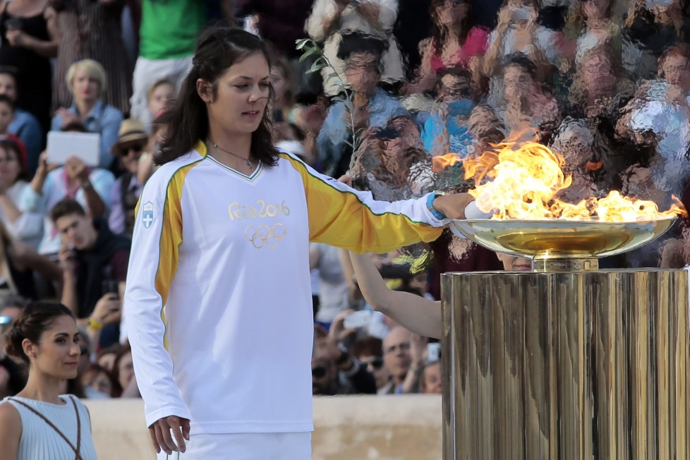 ATHENS, GREECE - APRIL 27: Rowing World Champion Katerina Nikolaidou of Greece lights the cauldron during the handover ceremony for the Olympic torch at Panathinean stadium on April 27, 2016 in Athens, Greece. .(Photo by Milos Bicanski/Getty Images)