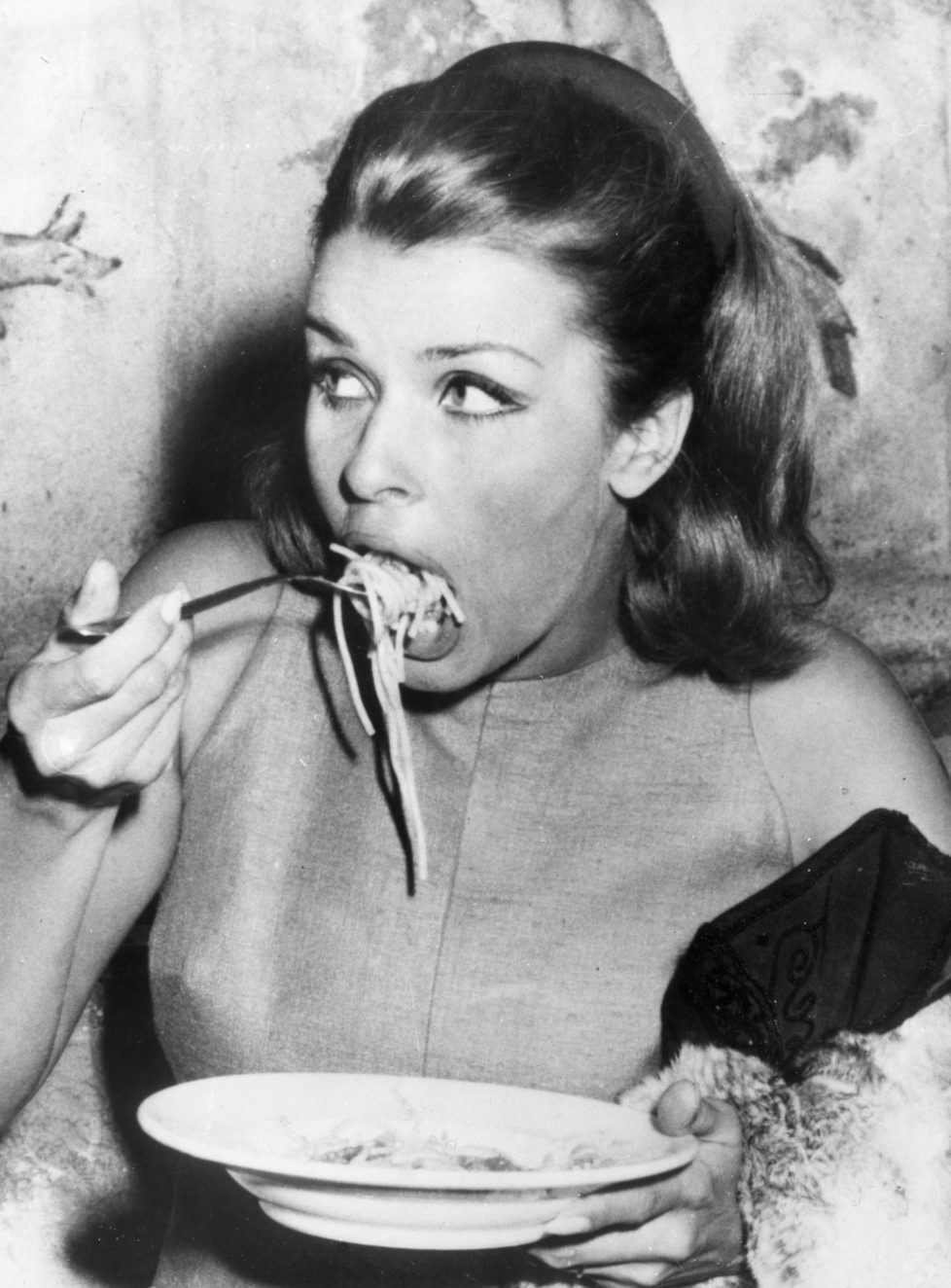 20th September 1966: Austrian actress, Senta Berger enjoying a plate of spaghetti at the Cinecitta in Rome during the filming of 8Operation Saint Gennarioe. (Photo by Keystone/Getty Images)
