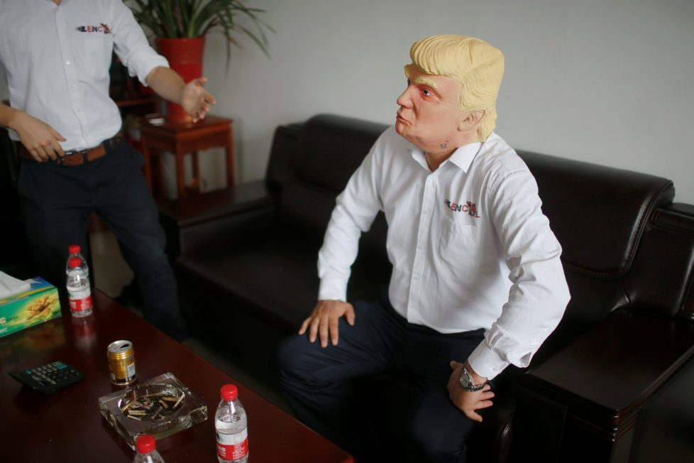 "The manager of Jinhua Partytime Latex Art and Crafts Factory wears a mask of U.S. Republican presidential candidate Donald Trump as he poses after talking to reporters in Jinhua, Zhejiang Province, China, May 25, 2016. There's no masking the facts. One Chinese factory is expecting Donald Trump to beat his likely U.S. presidential rival Hilary Clinton in the popularity stakes. At the Jinhua Partytime Latex Art and Crafts Factory, a Halloween and party supply business that produces thousands of rubber and plastic masks of everyone from Osama Bin Laden to Spiderman, masks of Donald Trump and Democratic frontrunner Hillary Clinton faces are being churned out. Sales of the two expected presidential candidates are at about half a million each but the factory management believes Trump will eventually run out the winner. ""Even though the sales are more or less the same, I think in 2016 this mask will completely sell out,"" said factory manager Jacky Chen, indicating a Trump mask. REUTERS/Aly Song SEARCH ""JINHUA MASK"" FOR THIS STORY. SEARCH ""THE WIDER IMAGE"" FOR ALL STORIES. TPX IMAGES OF THE DAY"