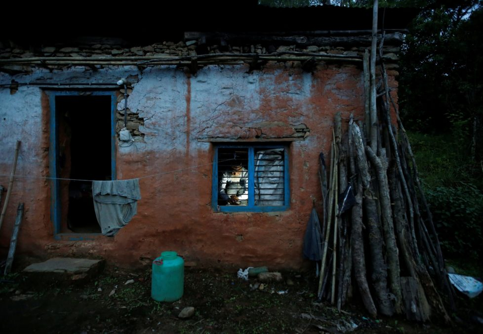 "Durga Kami, 68, who is studying in the tenth grade at Shree Kala Bhairab Higher Secondary School, is seen through the window as he prepares dinner for himself at his one room house in Syangja, Nepal, June 4, 2016. REUTERS/Navesh Chitrakar. SEARCH ""DURGA KAMI"" FOR THIS STORY. SEARCH ""THE WIDER IMAGE"" FOR ALL STORIES. TPX IMAGES OF THE DAY"