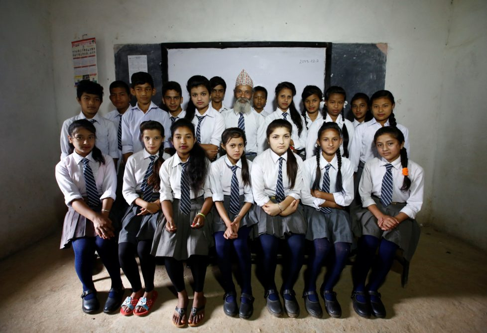 "Durga Kami (C), 68, and his classmates pose for a group picture in their classroom at Shree Kala Bhairab Higher Secondary School in Syangja, Nepal, June 5, 2016. REUTERS/Navesh Chitrakar. SEARCH ""DURGA KAMI"" FOR THIS STORY. SEARCH ""THE WIDER IMAGE"" FOR ALL STORIES. TPX IMAGES OF THE DAY"