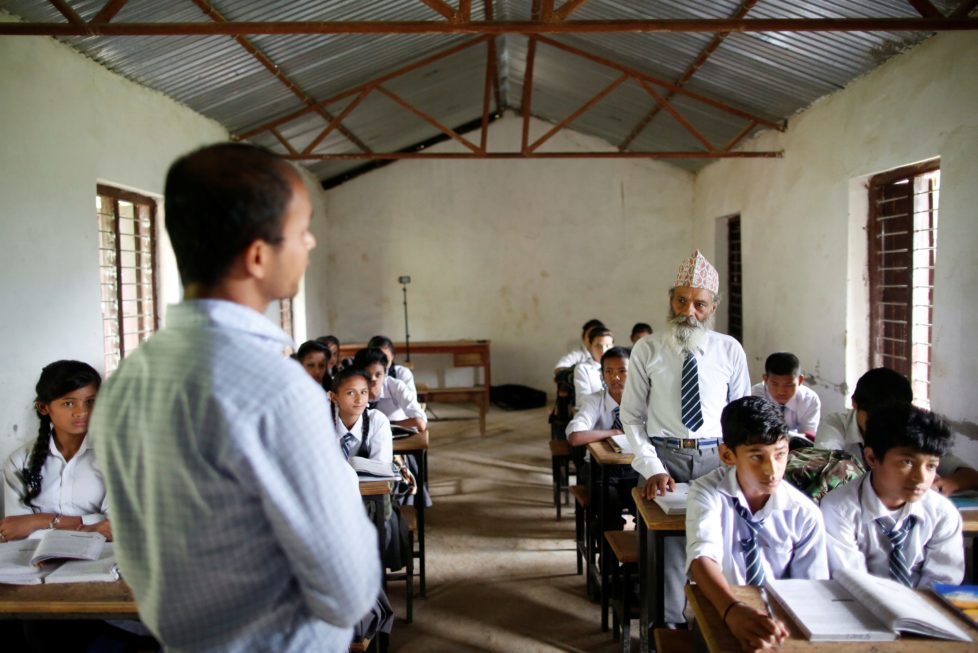 "Durga Kami, 68, who is studying in tenth grade at Shree Kala Bhairab Higher Secondary School, answers a question from his teacher as he attends a class in Syangja, Nepal, June 5, 2016. REUTERS/Navesh Chitrakar. SEARCH ""DURGA KAMI"" FOR THIS STORY. SEARCH ""THE WIDER IMAGE"" FOR ALL STORIES"