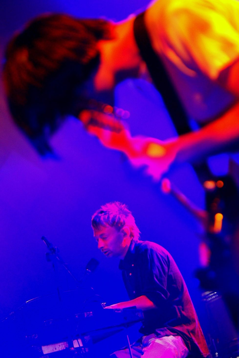 Thom Yorke, left, singer and Jonathan Greenwood, right, guitarist of british rock group Readiohead performs on Stravinsky stage, during the 37th Montreux Jazz Festival, in Montreux, Switzerland, Saturday, July 5, 2003. (KEYSTONE/Fabrice Coffrini)