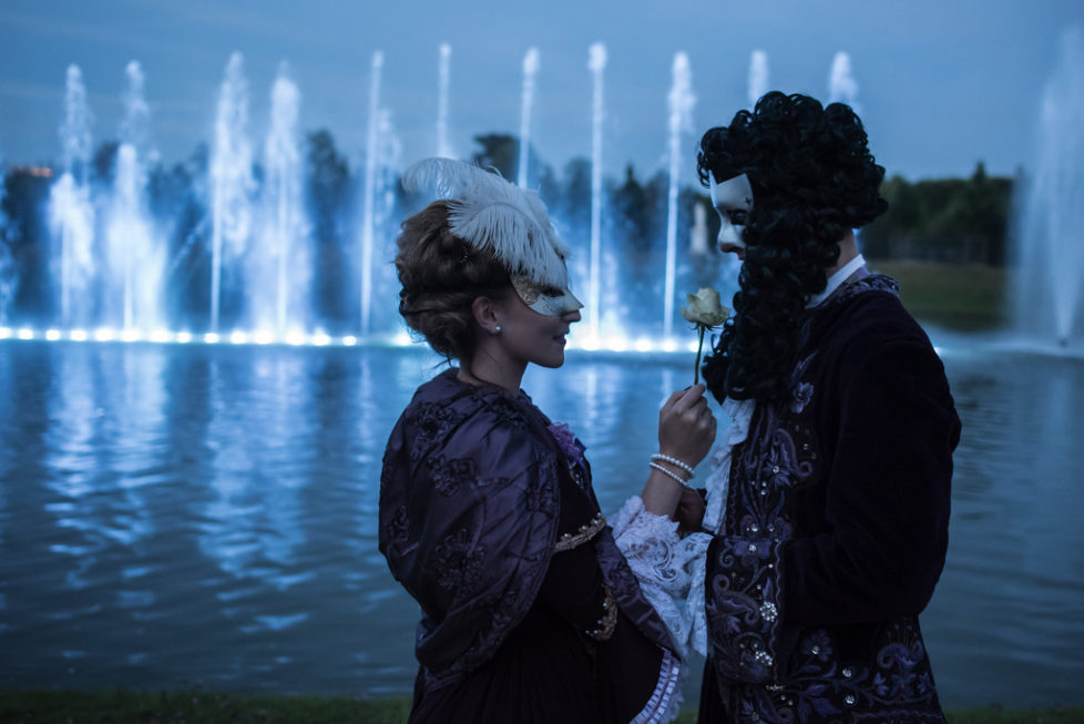 Gwendoline and Jordan stand in front a fountain in the gardens of the Versailles castle before the Great Masked Bal, in Versailles, west of Paris, Saturday, June 27, 2015. On the occasion of the tercentenary of King Louis XIV's death, who died on Sept.1, 1715, a fountains show and a costumed ball took place in the castle.(AP Photo/Kamil Zihnioglu)
