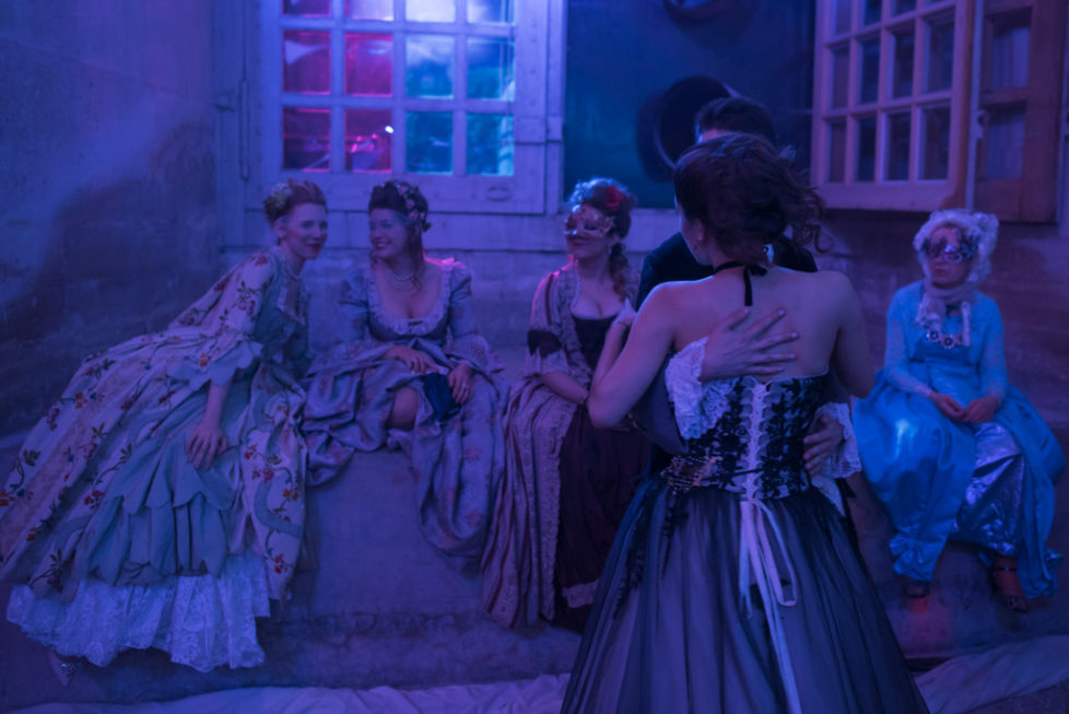 Costumed guests dance during the Great Masked Bal, in the Versailles castle, west of Paris, Saturday, June 27, 2015. On the occasion of the tercentenary of King Louis XIV's death, who died on Sept.1, 1715, a fountains show and a costumed ball took place in the castle.(AP Photo/Kamil Zihnioglu)