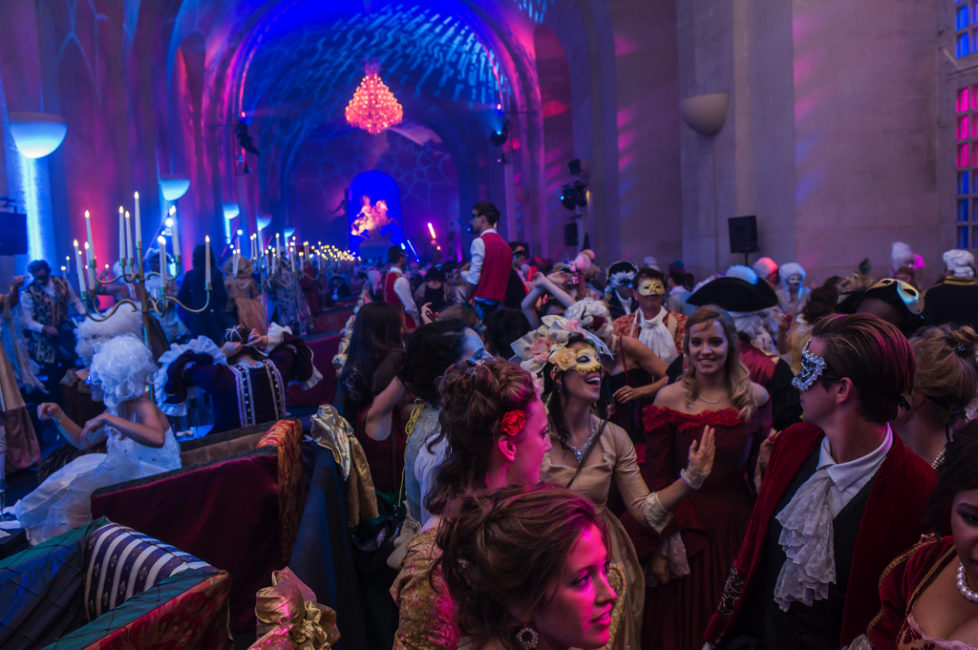 Costumed guests dance during the Great Masked Bal, in the Orangerie of the Versailles castle, west of Paris, Saturday, June 27, 2015. On the occasion of the tercentenary of King Louis XIV's death, who died on Sept.1, 1715, a fountains show and a costumed ball took place in the castle.(AP Photo/Kamil Zihnioglu)