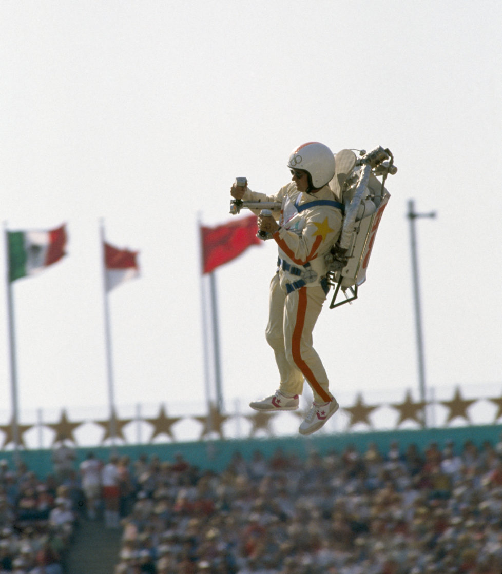 Bill Suitor wears a jet pack (or rocket pack) to propel himself into the Memorial Coliseum during the opening ceremony of the 1984 Summer Olympics in Los Angeles, United States on 28th July 1984. (Photo by Bob Thomas/Getty Images) *** Local Caption *** Bill Suitor