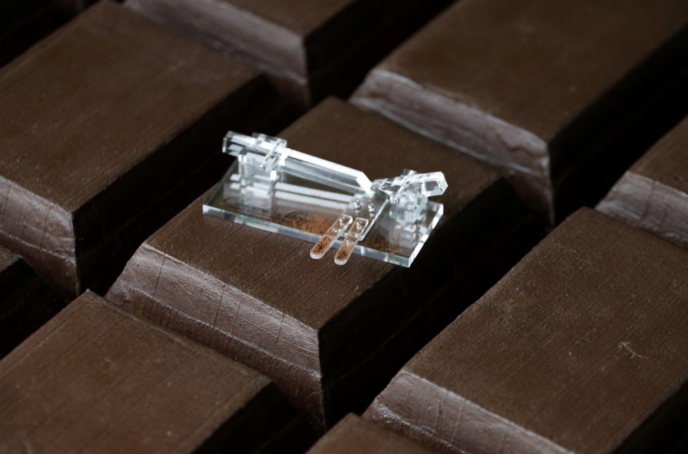 The Chocolate Shooter is displayed in the factory of Belgian chocolatier Dominique Persoone in Bruges, February 3, 2015. When Belgian chocolatier Dominique Persoone created a chocolate-sniffing device for a Rolling Stones party in 2007, he never imagined demand would stretch much beyond the rock 'n' roll scene. But, seven years later, he has sold 25,000 of them. Inspired by a device his grandfather used to propel tobacco snuff up his nose, Persoone created a 'Chocolate Shooter' to deliver a hit of Dominican Republic or Peruvian cocoa powder, mixed with mint and either ginger or raspberry. Picture taken on February 3, 2015. REUTERS/Francois Lenoir (BELGIUM - Tags: FOOD SOCIETY) - RTR4OIJ5