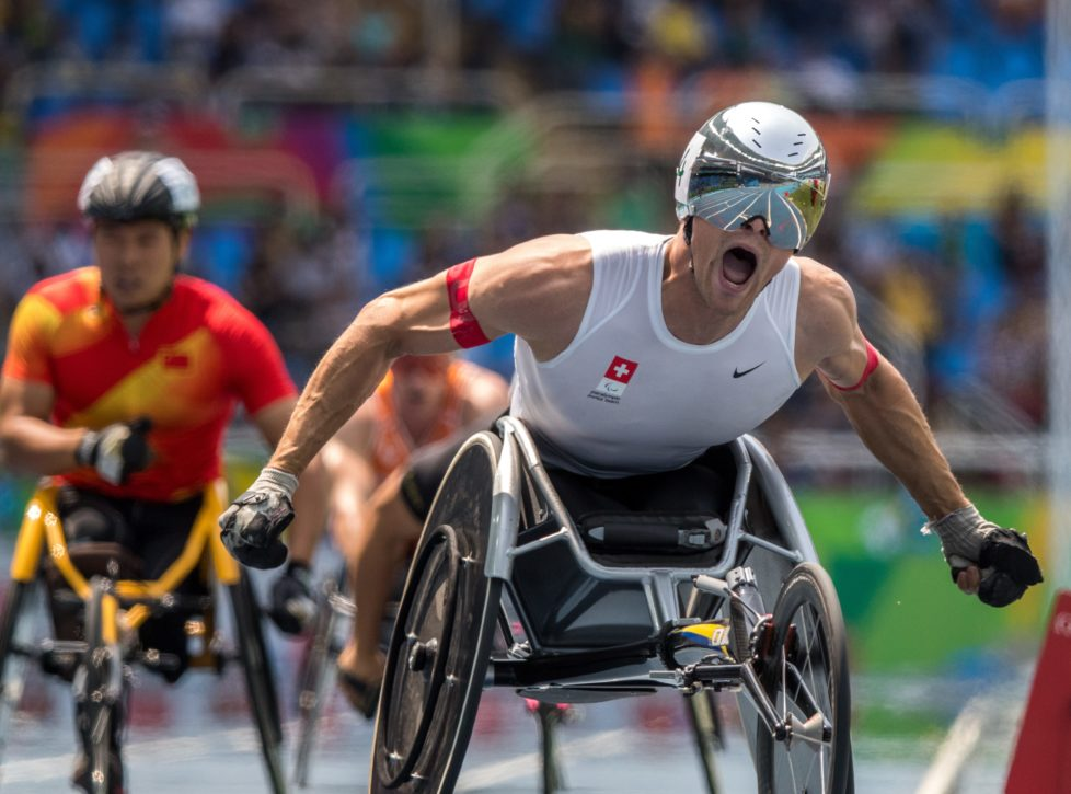 In this photo released by the IOC, wheelchair racer Marcel Hug, of Switzerland, celebrates winning the athletics men's final 800-meter T54 athletics event at Olympic Stadium during the Paralympic Games in Rio de Janeiro, Brazil, Thursday, Sept. 15, 2016. (Simon Bruty/OIS, IOC via AP)