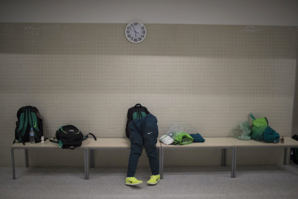 The prothetic legs of Brazil's Julio Braz lean on a bench in the locker room before his team's wheelchair rugby group A game with Australia at the Paralympic Games in Rio de Janeiro, Brazil, Thursday, Sept. 15, 2016. (AP Photo/Leo Correa)
