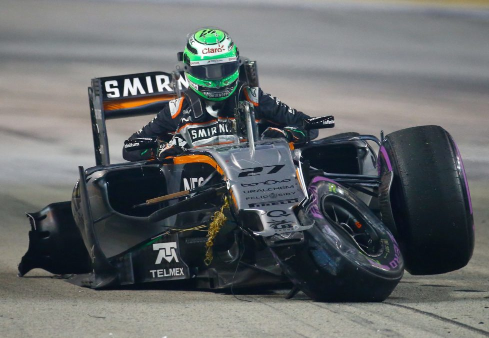 Formula One - F1 - Singapore Grand Prix - Marina Bay, Singapore- 18/9/16 Force India's Nico Hulkenberg reacts after crashing during the race. REUTERS/Jeremy Lee TPX IMAGES OF THE DAY