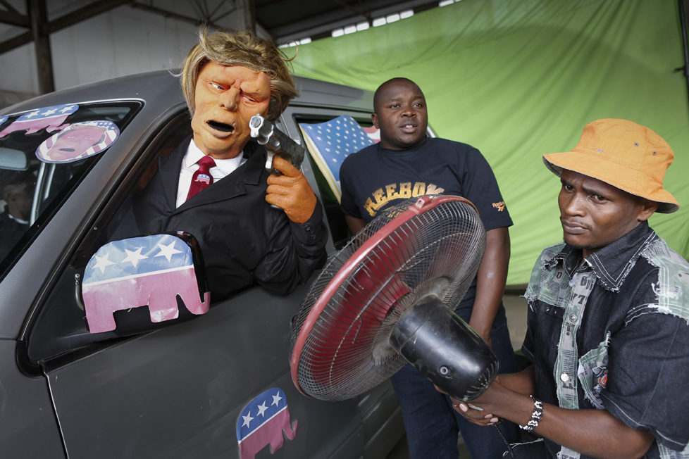 epa05548722 (04/19) A prodution assistant (R) uses a fan to lift up the hair of the Donald Trump puppet during the shooting of the 11th season of 'The XYZ Show' satirical puppet show at a studio in Nairobi, Kenya, 31 August 2016. The XYZ Show is Kenya's popular satirical television program and has been taking pokes at the country's political elites and international figures ever since it aired its first episode in 2009. With the 2016 US presidential elections, the show is now taking on Republican Presidential candidate Donald Trump. EPA/DAI KUROKAWA PLEASE REFER TO ADVISORY NOTICE (epa05548718) FOR FULL FEATURE TEXT