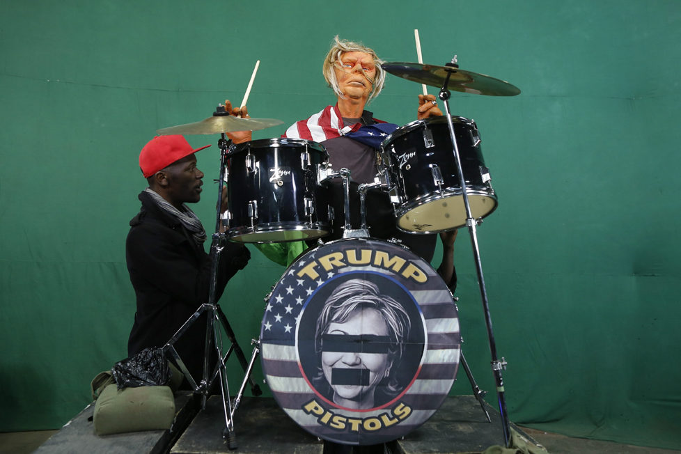 epa05548734 (16/19) Puppeteers control the Donald Trump puppet dressed as a punk rock star and singing the remix of 'God Save The Queen' by the Sex Pistols during the shooting of the 11th season of 'The XYZ Show' satirical puppet show at a studio in Nairobi, Kenya, 30 August 2016. The XYZ Show is Kenya's popular satirical television program and has been taking pokes at the country's political elites and international figures ever since it aired its first episode in 2009. With the 2016 US presidential elections, the show is now taking on Republican Presidential candidate Donald Trump. EPA/DAI KUROKAWA PLEASE REFER TO ADVISORY NOTICE (epa05548718) FOR FULL FEATURE TEXT