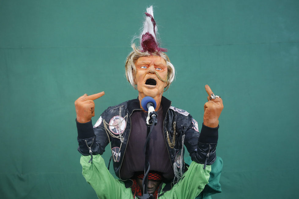 epa05548735 (17/19) Puppeteers control the Donald Trump puppet dressed as a punk rock star and singing the remix of 'God Save The Queen' by the Sex Pistols during the shooting of the 11th season of 'The XYZ Show' satirical puppet show at a studio in Nairobi, Kenya, 30 August 2016. The XYZ Show is Kenya's popular satirical television program and has been taking pokes at the country's political elites and international figures ever since it aired its first episode in 2009. With the 2016 US presidential elections, the show is now taking on Republican Presidential candidate Donald Trump. EPA/DAI KUROKAWA PLEASE REFER TO ADVISORY NOTICE (epa05548718) FOR FULL FEATURE TEXT