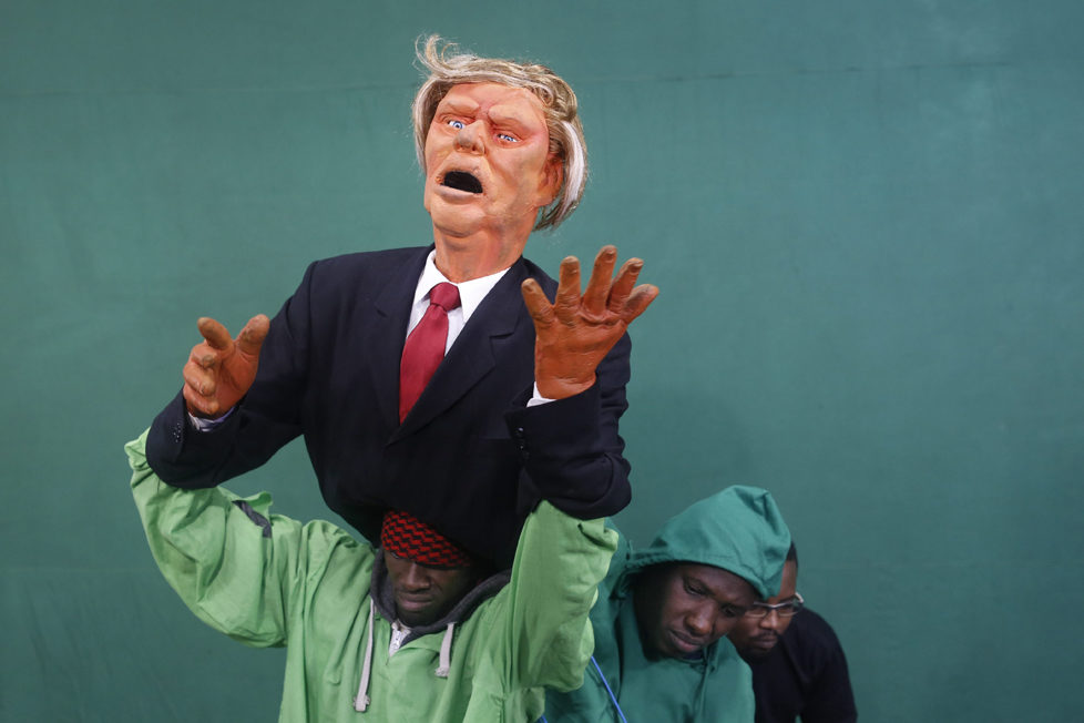 epaselect epa05548724 (06/19) Puppeteers control the Donald Trump puppet during the shooting of the 11th season of 'The XYZ Show' satirical puppet show at a studio in Nairobi, Kenya, 30 August 2016. The XYZ Show is Kenya's popular satirical television program and has been taking pokes at the country's political elites and international figures ever since it aired its first episode in 2009. With the 2016 US presidential elections, the show is now taking on Republican Presidential candidate Donald Trump. EPA/DAI KUROKAWA PLEASE REFER TO ADVISORY NOTICE (epa05548718) FOR FULL FEATURE TEXT