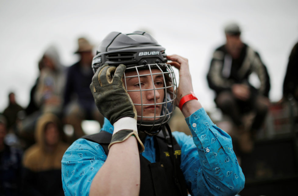 """A bull rider dons a helmet before competition at the Deni Ute Muster in Deniliquin, New South Wales, September 30, 2016. REUTERS/Jason Reed SEARCH """"UTE CULTURE"""" FOR THIS STORY. SEARCH """"THE WIDER IMAGE"""" FOR ALL STORIES."""