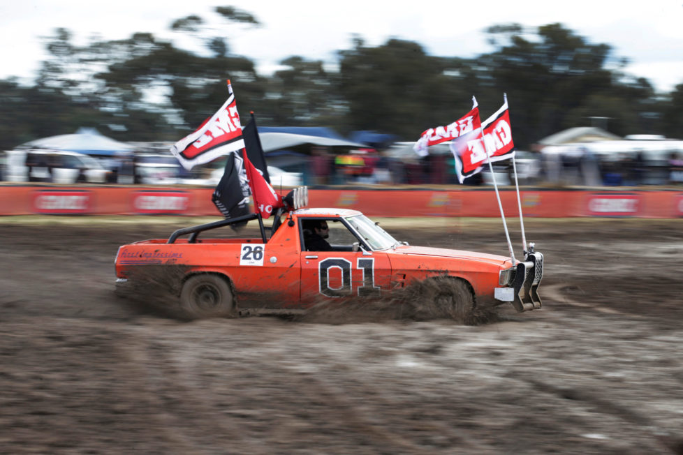 """Robert Dowse, 35, from Frankston in the Australian state of Victoria powers his Australian 'ute' he calls """"General Lee"""" through thick mud during a 'circle work' competition of vehicle handling skills at the Deni Ute Muster in Deniliquin, New South Wales, September 30, 2016. REUTERS/Jason Reed SEARCH """"UTE CULTURE"""" FOR THIS STORY. SEARCH """"THE WIDER IMAGE"""" FOR ALL STORIES."""