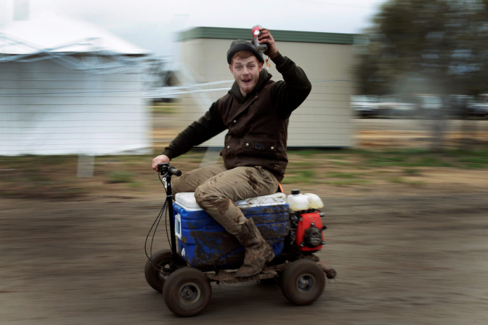 """Sheep shearer Chris Kermond from Ballarat in the Australian state of Victoria rides a motorised 'esky' or drink cooler, while drinking a can of pre-mixed rum and cola at the Deni Ute Muster in Deniliquin, New South Wales, September 29, 2016. REUTERS/Jason Reed SEARCH """"UTE CULTURE"""" FOR THIS STORY. SEARCH """"THE WIDER IMAGE"""" FOR ALL STORIES."""