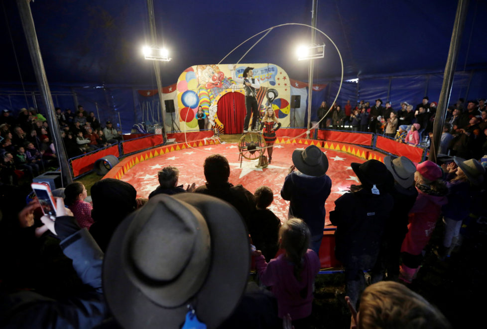 """Brophy Bros travelling circus performer Warren Brophy spins a 70 foot long lasso during a show under the big top at the Deni Ute Muster in Deniliquin, New South Wales, Australia, October 1, 2016. REUTERS/Jason Reed SEARCH """"UTE CULTURE"""" FOR THIS STORY. SEARCH """"THE WIDER IMAGE"""" FOR ALL STORIES."""