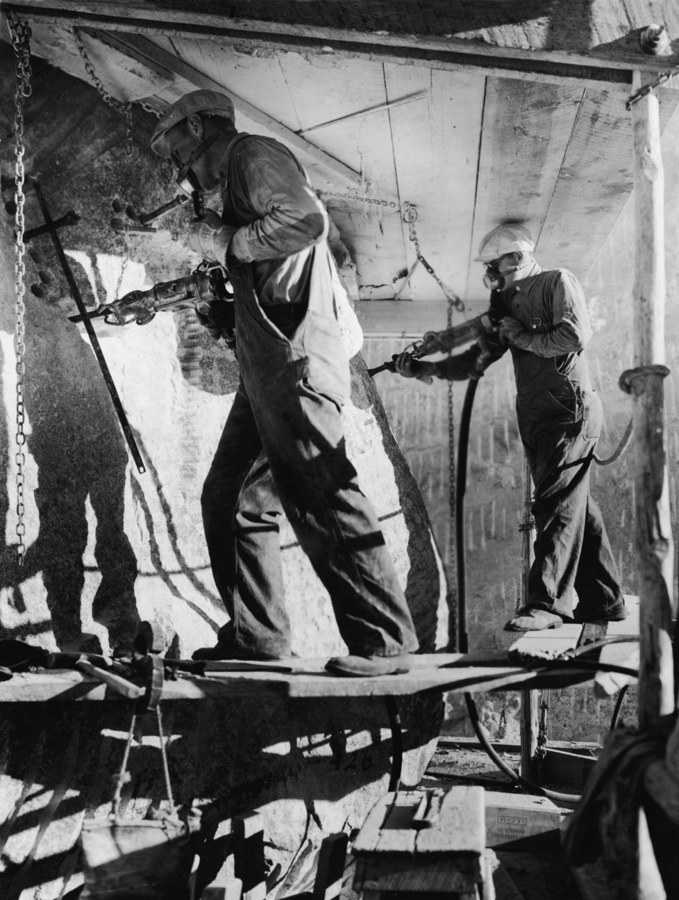 Stone workers carve the eyes of President Theodore Roosevelt with air hammers during the construction of the Mount Rushmore National Memorial in the Black Hills, Keystone, South Dakota, late 1930s to early 1940s. (Photo by Frederic Lewis/Getty Images)