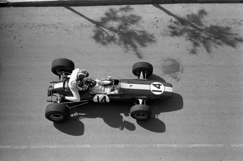 Graham Hill gives Jo Siffert a ride during practice, Monaco, Monte Carlo, 7 May 1967. (Photo by Rainer W. Schlegelmilch/Getty Images) *** Local Caption *** Graham Hill;Jo Siffert