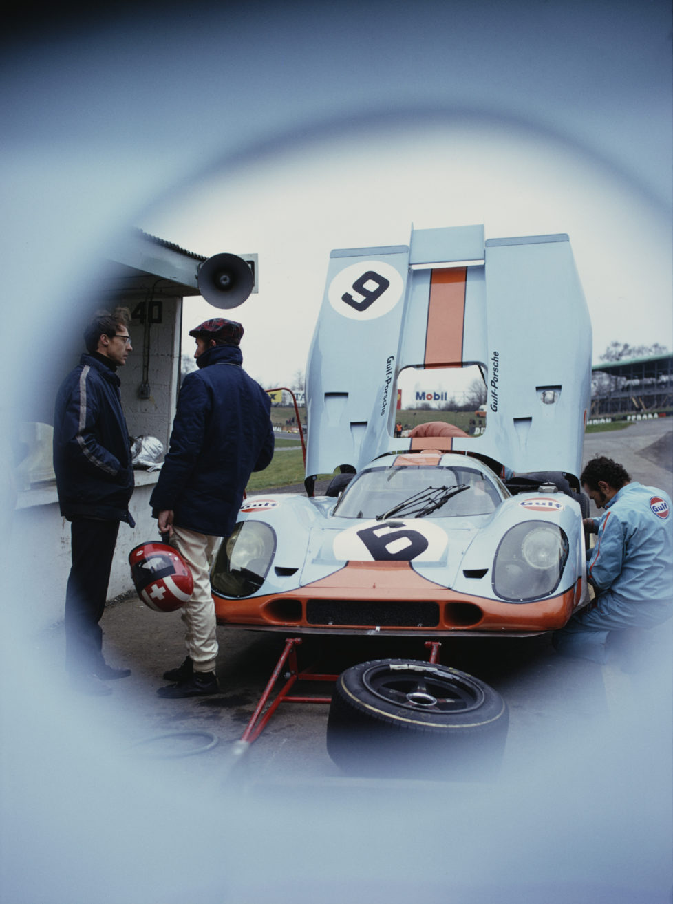 Jo Siffert of Switzerland stands beside the #6 JW Automotive Engineering Gulf Porsche 917K during practice for the International Championship for Makes BOAC 1000 Kilometres of Brands Hatch race on 3rd April 1971 at the Brands Hatch Circuit, Fawkham, Great Britain. (Photo by Rainer W. Schlegelmilch/Getty Images) *** Local Caption *** Jo Siffert