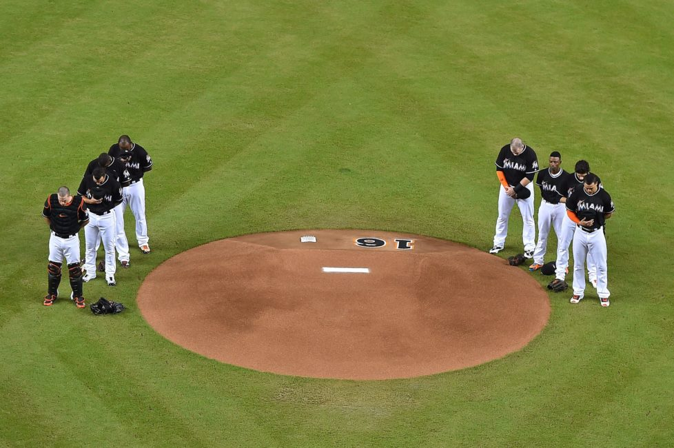 Sep 26, 2016; Miami, FL, USA; Miami Marlins teammates gather around the mound to honor Miami Marlins starting pitcher Jose Fernandez before the game against the New York Mets at Marlins Park. Mandatory Credit: Jasen Vinlove-USA TODAY Sports