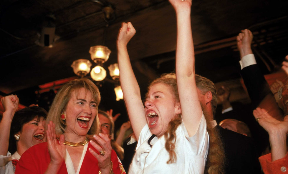 Hillary Rodham Clinton & daughter Chelsea cheering for presidential nominee husband/dad Bill Clinton, latter raising arms in excitement, on floor of Democratic Natl. Convention. (Photo by Steve Liss/The LIFE Images Collection/Getty Images)