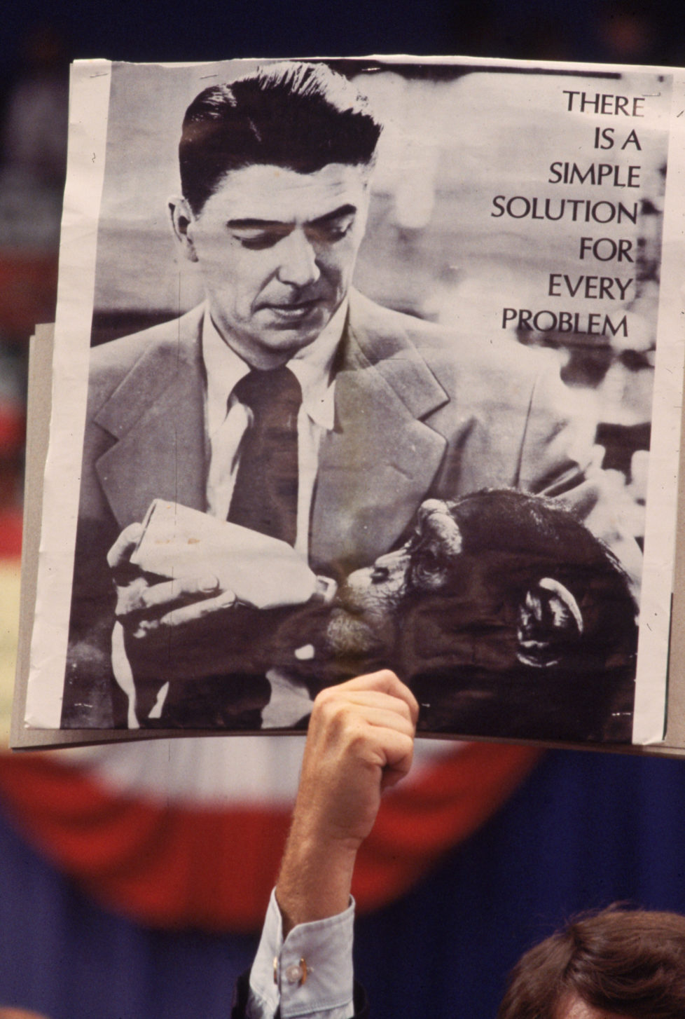 1980: A poster depicting Ronald Reagan bottle feeding a chimp is held aloft at a Democratic Convention in New York. (Photo by Luiz Alberto/Keystone Features/Getty Images)