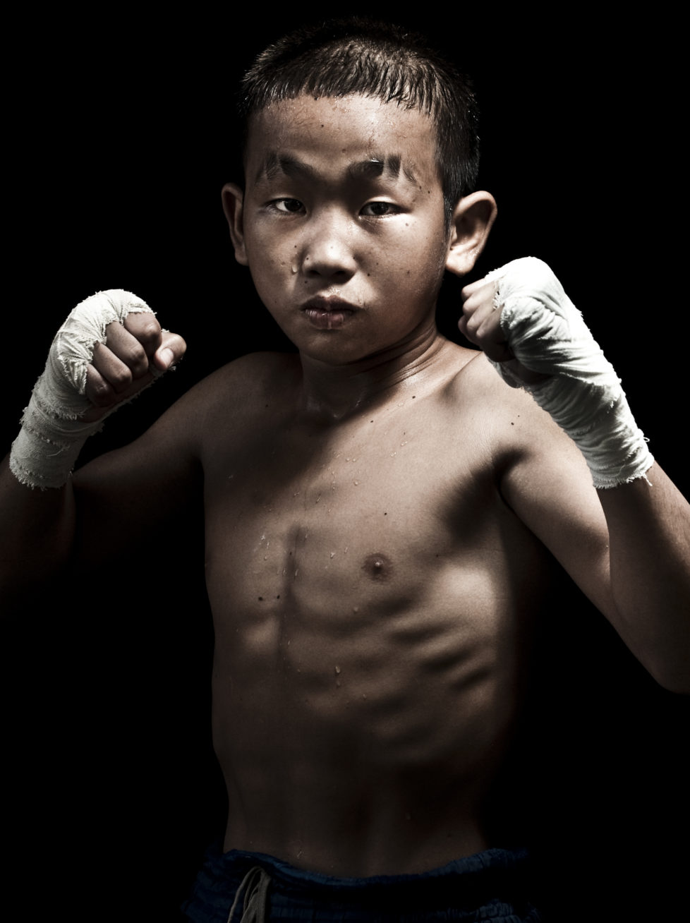 """Muay Thai Kickboxing fighter Petchwiengian of Laos poses at Sangmorakot gymnasium in Bangkok, Thailand. Muay Thai, also know as """"Art of Eight Limbs"""", is a combat martial art and Thailand's national sport. (Photo by Victor Fraile/Corbis via Getty Images)"""