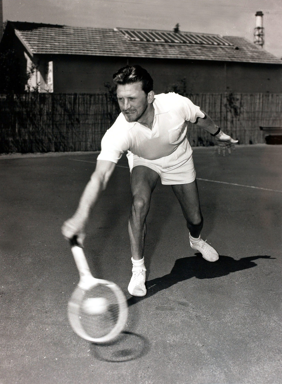 Cinema Personalities, pic: 18th April 1953, American film actor Kirk Douglas pictured playing tennis in Cannes, South of France (Photo by Popperfoto/Getty Images)